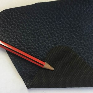 Blue Vinyl or 'PU' Leather with fabric backing and embossed 'Grain'